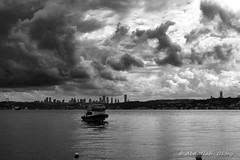 Seascape 21 (`ARroWCoLT) Tags: seascape streetphotography sokak people blackwhite bw art insan human arrowcolt monochrome bnwdemand bnwpeople bnw bnwstreet ishootpeople blackandwhite outdoor canon200d 1855stm primelens seaside waterfront port iskele beykoz clouds bulut boat tekne alone sea ocean water sky
