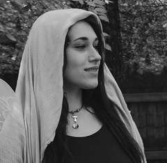 Merchant of Wings (clarkcg photography) Tags: blackandwhite bw blackwhite woman headcovering cool rainy renaissance wings merchant peddler forest fantasy sparklewings