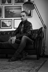 Sitting man (FODA_82) Tags: longhair sw blackwhite blackandwhite dark badboy leather bw people portraits einfarbig portrait man personen mann langeshaar manbun bun nikon d750 tamron