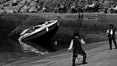 It wasn't me  ! (Neil. Moralee) Tags: neilmoralee piratebrixhamneilmoralee pirate ship boat mooring problem tide wate sea ocean accident error hanging susoended funny black white bw bandw blackandwhite people costume captain blame rage anger neil moralee nikon d7200