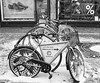 Iced Coffee (tcees) Tags: károlykrt budapest hungary pest urban x100 fujifilm finepix snow snowing sidewalk pavement streetphotography street road cycle bicycle bikeracks building shops starbucks shoes bike bw mono monochrome blackandwhite