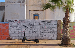 the wizzard on the wall (mhobl) Tags: wall writing palmtree escooter sidiifni moroc