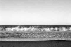 waves. seacliff beach, ca. 1999. (eyetwist) Tags: eyetwistkevinballuff eyetwist surf beach waves sand horizon seacliff aptos santacruz longexposure nikon n90s agfa agfapan apx 100 nikonn90s agfaapx100 sigma2470f28exdg scansfromthearchives ishootfilm ishootkodak film analog analogue lenstagger 35mm blackwhite bw contrast monochrome california pacificocean montereybay capitola minimalist seascape black white