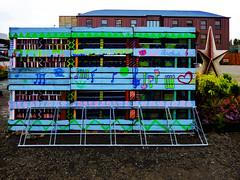 The Pallet Bike Rack (Steve Taylor (Photography)) Tags: aroha notes music bikerack star heart peterboroughstreet graffiti art streetart symbol plant newzealand nz southisland canterbury christchurch cbd city pallet flowerbed