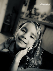 Genuine Smile (Randy • R) Tags: 6s 6splus madelyn nc northcarolina us usa unitedstates amazing beautiful blackandwhite bokeh cell child dark daughter eyes face family girl home house image individual indoor indoos inside iphone kid mobile mono monochrome nice people person phone photo photographer photography pic picture portrait pretty randall sepia tonedimage