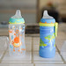 Soft spouted sippy cups on kitchen counter from NUK with caps off to the side