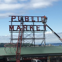 Fixing the Sign (evil robot 6) Tags: pikeplacemarket sign seattle