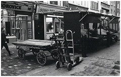 Market Stalls (peterphotographic) Tags: img029edwm marketstalls olympus om2n zuiko ©peterhall soho berwickstreet berwickstreetmarket london england uk britain market shop stall trolley empty closed 35mm film analog scanned jch jchstreetpan400 streetpan japanesecamerahunter