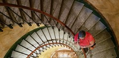 Hermitage stairwell with man in red (overthemoon) Tags: switzerland suisse schweiz svizzera romandie vaud lausanne hermitage expo exhibition pastels pastellistes architecture stairs marches escalier puits balustrade curves shadows man red phone