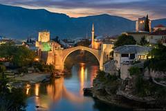 The Old City of Mostar || Herzegovina (sousapp) Tags: 0historicalcitiesandworld 0portfolio 0portfolioexpanded 1europe 2bosniaherzegovina reflection architecture bluehour bridge city easterneurope europe mostar night starimost sunset travel 0historicalcitiesandworldheritagesites