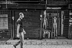 Jail (aliwton) Tags: ifttt 500px man monochrome walk black white noir leica hybrid film digital silver gelatin street urban travel people candid mannequin dummy naked empty closed clothing fashion commerce metal bars prison recife pernambuco brazil south america
