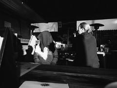 Ten Bells (BurlapZack) Tags: olympustoughtg5 vscofilm pack06 dallastx oakclifftx tenbellstavern brunch candid strangers kid clothnapkin hood mask dreadritual bw mono monochrome street table food bar pub tavern eats date wideangle pointandshoot compact digitalcompact advancedcompact waterproofcamera waterproofcompact toughcompact raw sunlight magichour light shadow