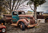 Line Up (HTT) (13skies) Tags: pickuptruck old vintage antique jalopy truck singleshothdr rusted sitting relic truckthursday pickup happytruckthursday notl niagaraonthelake winery sonya57 topaz trees tires lights grill cool sign speed