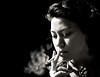 smokin' .... (daystar297) Tags: streetportrait portrait bw bnw blackandwhite monochrome girl woman smoking cigarette smoke people face closeup nikon