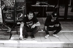 Smoke Break (D. R. Hill Photography) Tags: bangkok thailand thai asia southeastasia city urban street streetphotography smoke smokebreak pizzahut break blackandwhite monochrome analog 135 35mmfilm grain contax contaxg1 g1 kodak kodakfilm kodaktrix400 trix carlzeissplanar35mmf2 planar 35mm primelens fixedfocallength zeiss