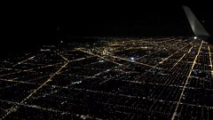 Flying into Chicago, great lakes in the distance, city lights, traffic, streets, from above, Chicago, Illinois, USA (Wonderlane) Tags: 20141103204211 flyingintochicago greatlakesinthedistance citylights traffic streets fromabove chicago illinois usa