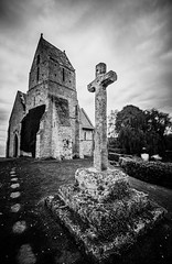 "moody fine art black & white view of the lovely little Eglise St Martin in the small village of Cricquebœuf near Honfleur, Calvados, Normandy, France (grumpybaldprof) Tags: cricquebœuf ""smallcommune"" village calvados normandy normandie france ""10thcentury"" ""eglisestmartin"" ""chapelleauxlierres"" honfleur church chapel eglise mood moody atmosphere coulds cross bw blackwhite ""blackwhite"" ""blackandwhite"" noireetblanc monochrome ""fineart"" ethereal striking artistic interpretation impressionist stylistic style contrast shadow bright dark black white illuminated canon 70d ""canon70d"" sigma 1020 1020mm f456 ""sigma1020mmf456dchsm"" ""wideangle"" ultrawide"