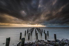 Seen Better Days (Antony Eley) Tags: pier wharf jetty poles abandoned ruin disused sunset sky clouds burkestreetwharf thames
