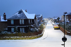 Sandown Snow Scene (Inner Vision Productions) Tags: innervisionphotography innervisionpress innervision mattblythe sandown isleofwight dslr nikon d5200 scene christmas snowing fall falling blizzard fresh white dusk lowlight longexposure night evening cosy house street cottage road virgin roof rooftop covering angel light lighting urban town perspective vanishing point truck pavement sidewalk nopeople tranquil peaceful quiet empty weather winter cold ice freeze freezing season seaonal extreme climate change global warming environment