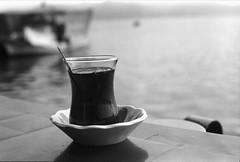 Bostanlı Balıkçı Barınağı / Izmir (-daniska-) Tags: bwfilm analog nikon bw filmisnotdead olympus bostanlı izmir balık balıkçi halı tekne barınak 50mm 14 ilford panf 50 negative film