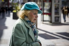 The Blue Hat (Leanne Boulton) Tags: portrait urban street candid portraiture streetphotography candidstreetphotography candidportrait streetportrait streetlife profile old elderly woman female eyes face expression backlit sunlight fluffy hat blue green blonde tone texture detail depthoffield bokeh naturallight outdoor light shade shadow city scene human life living humanity society culture style fashion people canon canon5d 5dmkiii 70mm ef2470mmf28liiusm color colour glasgow scotland uk