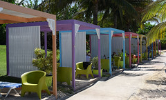 Beach Cabanas (Poocher7) Tags: jamaica westindies caribbean sand beach cabanas pastelcolours palmtrees shade loungechairs greenchairs relaxation sidewalk sundaylights
