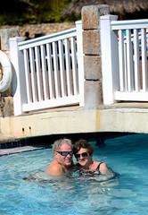 Fifteen Years Later..... (Poocher7) Tags: couple seniors people portrait love romance longtimelove water pool bridge resort affection smiles bathingsuits embracing jamaica westindies caribbean mymomanddad mom dad parents