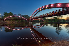 The Tridge at Night in Midland Michigan, USA (Craig - S) Tags: tridge bridge footbridge michigan midland midwest river reflections mirrored chippewa tittabawassee tricities confluence chippewassee park night twilight evening sunset bluehour lights spring background beauty nature outdoors scenic tourism travel