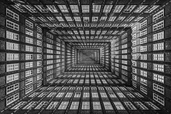 endless (Blende1.8) Tags: composing chilehaus hamburg architecture architektur symmetry symmtrie inneryard innenhof lichthof abstract mono monochrome schwarzweiss black white ultraweitwinkel ultrawideangle germany deutschland carstenheyer surreal sw schwarz weis facade windows fassade fenster