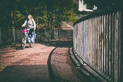 uphill (D Cation) Tags: scotland glasgow charingcross footbridge railing cyclist sunshine 50mmf12 niftyfifty