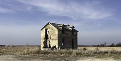 Pearl, Kansas (unknown quantity) Tags: sky clouds horizon shadows abandonedhouse brokenroof openwindows brokenwalls unpaintedwood baretrees crumbling junk field weathered neglected cloudsstormssunsetssunrises
