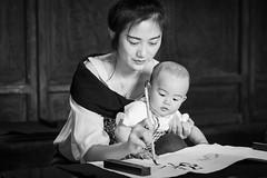 Deal mom! (frank.gronau) Tags: paint paper girl baby woman frau mom vertrag contract shanghai white black weis schwarz alpha sony gronau frank