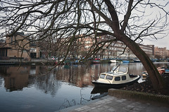 Amsterdam in the morning (Dmitry Yelloff) Tags: amsterdam netherlands travel tourist canal architecture house tourism water nobody river view european gable old waterway building reflection ages float city outdoors home dutch boat sky looking structure vessel sightsee europe exterior spring morning tree holland