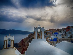 Cloudy Sunset in Oia (Tryfon Karagian) Tags: sunset greece greekisland aegean mediterranean hdr cityscape sea seashore church bell tower travel sky cloudy clouds outdoor