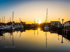 Hull Mariner Sunrise (Mark Lindstrom) Tags: sailing humber eastyorkshire kingstonuponhull morning calm sunburst water reflection sunrise yatch mariner hull
