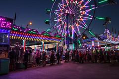 Lineup for the Big Wheel (vanessa_macdonald) Tags: carnival ferriswheel nightphotography longexposure festival buccaneerdays lights
