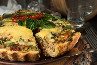 French opened pie quiche with tuna / chicken, broccoli, spinach, pepper, eggs, cheese and dried tomato.