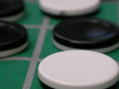 Othello! (noahg.) Tags: white black macro green fun dof bokeh capecod strategy othello gameboard reversi cotcpersonalfavorite sanyoc6 noahbulgaria