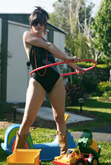 Fun in Suburbia (quebon2) Tags: portrait woman sun sunglasses topv111 truck fun toys jennifer sunny suburbs panther hulahoop tonka interestingness77