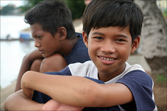 Khmer Smile: Sna (mboogiedown) Tags: poverty street travel boy smile children asian hope kid asia cambodia cambodian khmer child culture southeast streetkids cultural phnom penh sna kampuchea mapcambodia pehn cambogia theravada travelforpeace camboge beatravelernotatourist dontjustseetheworldexperienceit experiencecambodia buddhistnations ifthephotographerisinterestedinthepeopleinfrontofhislensandifheiscompassionateitsalreadyalottheinstrumentisnotthecamerabutthephotographer~evearnold