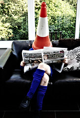 reading the newspaper (hool a hoop) Tags: film newspaper traffic cone surrealism conservatory couch dailymail
