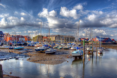 Eling Harbour (Joe Dunckley) Tags: uk england water clouds reflections boats hampshire nationalparks newforest hdr southamptonwater eling