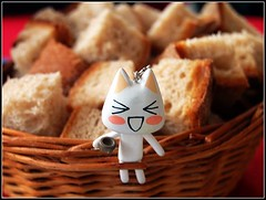 (natasha.diva) Tags: trip travel summer dinner cat bread table toy schweiz switzerland europe swiss sony luzern 2006 kawaii katze lucerne toro brot korb