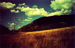 (Yellow Bear) Tags: copyright mountains landscape lomo lca lomography crossprocessed fields pylons coulds allrightsreserved clairegriffiths