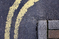 Yarmouth 30 Sep 06 (Auntie P) Tags: road street abstract lines yellow corner pavement ground sidewalk lookdown curve kerb grounded msh0810 msh081020