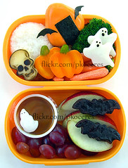 Halloween bento 10-14-06 (pkoceres) Tags: orange chicken japan lunch skull wings box sauce ghost egg bat salmon broccoli caramel glowinthedark onigiri carrot brownie apples bento creamcheese wasabi dip grape cheddar bats nori   eggroll kamaboko   icookedthis whitecheddar beefgyoza  charaben