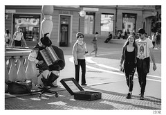 asian tourist, couple and sleeping accordionist (Aljaž Anžič Tuna) Tags: asiantourist coupleandsleepingaccordionist ljubljana slovenia street streetphotography people humans photo365 project365 onephotoaday onceaday 365 35mm 365challenge 365project nikond800 nikkor nice naturallight nikon nikon105mmf28 d800 dailyphoto day bw blackandwhite black white blackwhite beautiful