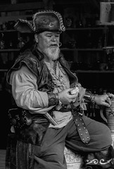 Yarns of the Highsea! (clarkcg photography) Tags: pirates man male beard mustache curl hat story blackandwhite blackwhite bw portrait