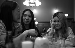 art of conversation (explored) (Chilanga Cement) Tags: fuji fujix100f fujifilm xseries x100f blackandwhite bw monochrome pub girls candid talking conversation