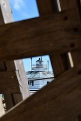 Framed (Chesapeake Bay Maritime Museum Photos) Tags: chesapeakebaymaritimemuseum stmichaelsmd waterfront lighthouse shipyard boats water miles river authentic chesapeake cbmm
